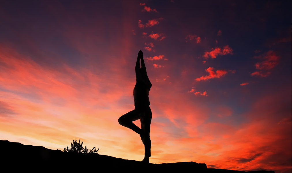 image of someone doing yoga at sunset